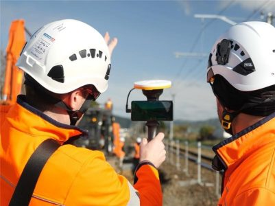 Two rail workers using augmented reality for machine avoidance
