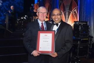 John Dring and Ravi Ravitharan holding John's RTSA Life Membership award