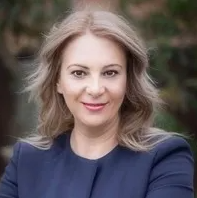 Head shot of Lidija Dumbaloska in smart workwear