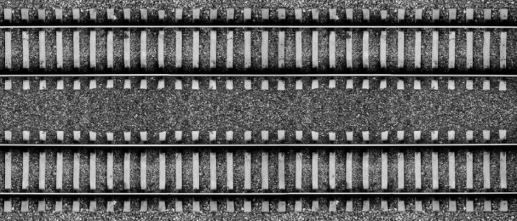 birds eye view of two parallel sections of track surrounded by ballast