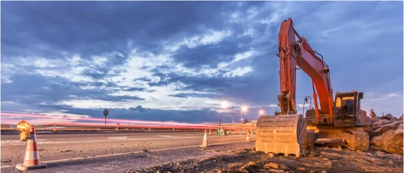 Engineers Australia image of an excavator at the side of a road at dusk
